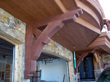 Trusses, are not only for the roof.  Remove support post for overhanging balconies.
